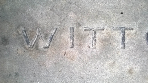 A CLOSER VIEW OF THE LETTERING AFTER CLEANING OF THE SANDSTONE WITH TRACES OF THE ORIGINAL BLACK PAINT CLEARLY VISIBLE.